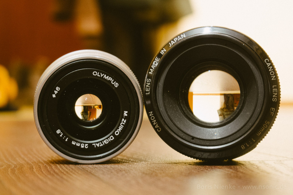 Olympus 25mm/1.8 vs. Canon 50mm/1.8